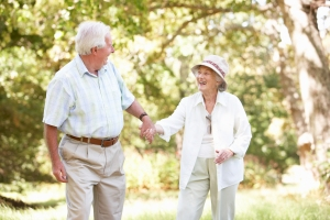 bigstock-senior-couple-walking-in-park-13916177