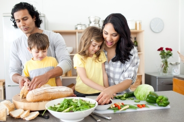 Positive family preparing lunch together in the kitchen